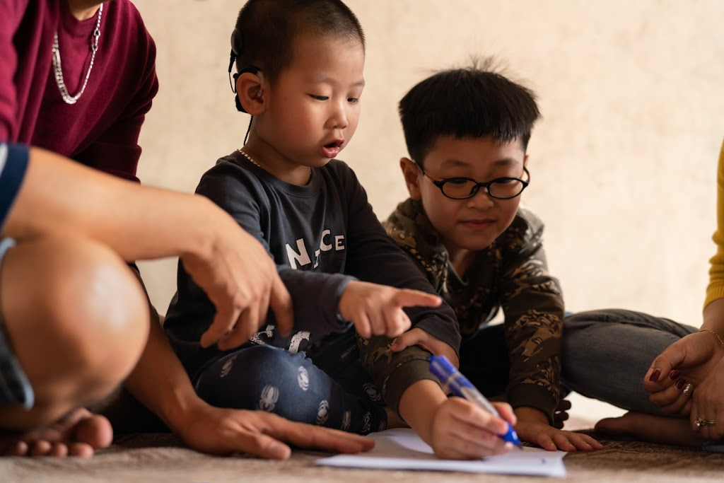 Young Beneficiary of Vietnam CI Project Learns to Listen and Talk
